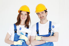 Couple with paint rollers Royalty Free Stock Photography
