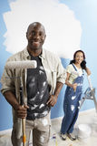 Couple With Paint Rollers Stock Photos