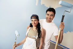 Couple With Paint Rollers Smiling Stock Image