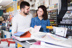 Couple in paint supplies store stock images