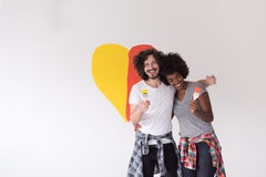 Couple with painted heart on wall stock photos