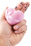Couple painted on man's fingers. Couple painted on man's fingers and gift box in the form of heart royalty free stock images