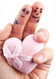 Couple painted on man's fingers and gift box. Couple painted on man's fingers and gift box in the form of heart stock photos