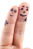 Couple painted on man's fingers. Royalty Free Stock Photos