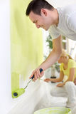Couple painters at home. Young couple painters in their apartment Stock Photos