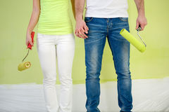 Couple painters with paint rollers. Legs of couple painters with paint rollers Stock Images