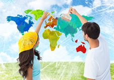 Couple painting Colorful Map with bright sky background Stock Photography