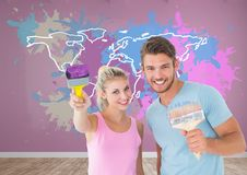 Couple painting a Colorful Map with paint splattered wall background Stock Image