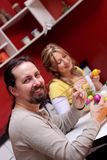 Couple is painting easter eggs Stock Images