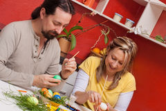 Couple painting Easter eggs together Royalty Free Stock Photography