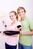 Couple painting home Stock Photo