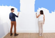 Couple painting new house Stock Photography
