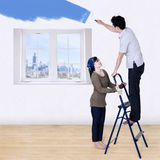 Couple painting new room Stock Image