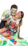 Couple painting over white. Young couple painting over white Stock Image