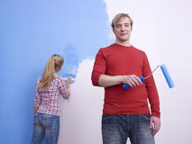 Couple painting room blue Stock Images