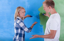 Couple painting room for two colors Royalty Free Stock Photos