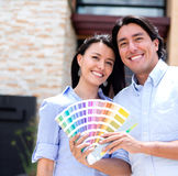 Couple painting their house Stock Photos