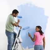 Couple painting together. Royalty Free Stock Photo