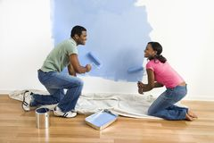 Couple painting wall. Royalty Free Stock Photos