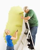 Couple painting wall. Royalty Free Stock Image