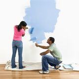 Couple painting wall blue. royalty free stock images