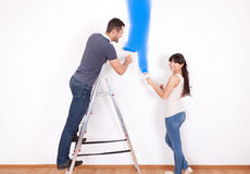 Couple painting wall at home Stock Photos
