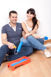 Couple painting wall at home Stock Photography