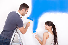 Couple painting wall at home Stock Images