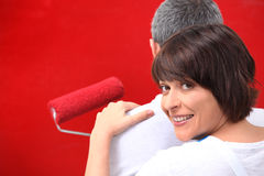 Couple painting a wall Royalty Free Stock Photos