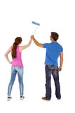Couple painting a wall together Stock Images