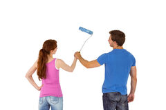 Couple painting a wall together Stock Image