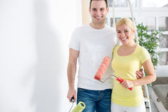 Couple painting wall Stock Photo