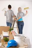 Couple painting walls together Stock Photography