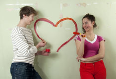 Couple paints heart Royalty Free Stock Photo