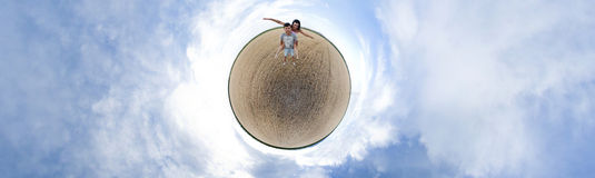 Couple panorama. Little planet panorama with a couple in cropland Stock Photos