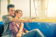 Couple on a panoramic wheel Royalty Free Stock Images