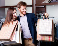 Couple with paper bags is in the shop Stock Image