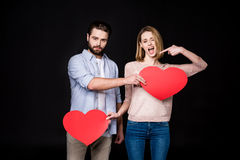 Couple with paper hearts Royalty Free Stock Images