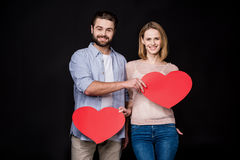 Couple with paper hearts Royalty Free Stock Photography