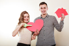 Couple with paper house and heart love symbol. Stock Photos