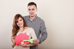 Couple with paper house. Housing real estate. Stock Photo