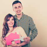 Couple with paper house. Housing real estate. Royalty Free Stock Photography