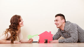 Couple with paper house. Housing real estate. Royalty Free Stock Photos