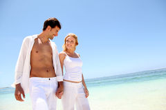 Couple on paradisiacal beach Royalty Free Stock Image