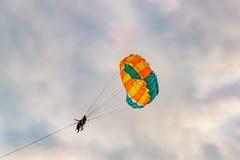 Couple parasailing on Langkawi island, Malaysia Royalty Free Stock Photos