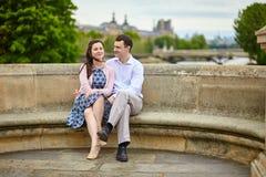 Couple in Paris on a bridge Stock Images