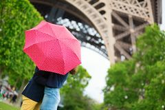 Couple in Paris kissing under rain Stock Image