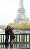 Couple in Paris at rain Stock Photography