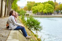 Couple in Paris, on the Seine embankment Stock Photos