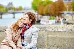 Couple in Paris, on the Seine embankment Royalty Free Stock Image